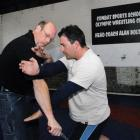American instructor Mike Janich, from Denver, corrects Auckland man Andrew Cater's blocking...