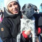 Amy Zareei and huntaway-heeler cross Boo find a vantage point to watch the Dog Derby competitors...