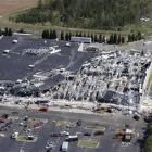An aerial photo shows tornado damage at the Lowes Home Improvement Center in Sanford, North...