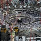 An aerial view shows Muslim worshippers praying at the Grand mosque surrounded by construction...