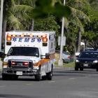 An ambulance leaves the area where President Barack Obama and his family is staying in Kailua,...