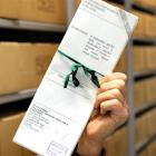 An archivist holds a copy of Margaret Cullen Bain's will, kept at Archives New Zealand's Dunedin...
