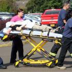 An injured person is taken from the college. Photo: Reuters
