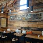 An original sign is displayed inside The Boatshed Cafe & Bistro at Frankton Marina. Much of the...