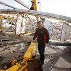 An Ottaway Amusement employee walks around the Century Wheel in Wichita, Kansas. The Ferris wheel...
