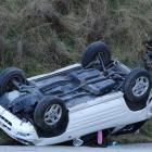 An overturned  car in Fernhill Rd, Queenstown, yesterday, near the Sainsbury Rd turnoff. Photo by...
