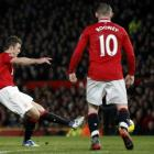 anchester United's Michael Carrick (L) scores against Bolton Wanderers during their Premier...