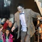 Andersons Bay School pupil Jake Remon (left, 10) joins the zombie tour led by science...