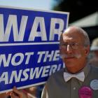 Andre Sheldon, from the group 'Global Strategy of Non-Violence', holds a sign during an anti-war...