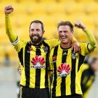 Andrew Durante and Ben Sigmund of the Phoenix celebrate the win after the final whistle during...