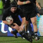 Andrew Hore scores a try during the All Blacks and Fiji at Carisbrook. Photo by Peter McIntosh.