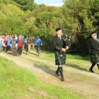 Andrew McColm (left) and Gordon Watson, of the Dunedin City Pipe Band, lead a group of 80 walkers...