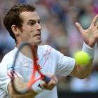 Andy Murray of Britain hits a return to Jo-Wilfried Tsonga of France during their men's semifinal...