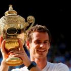 Andy Murray of Britain holds the winners trophy after defeating Novak Djokovic of Serbia in their...