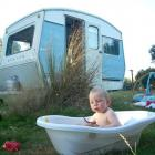 Angus Winneke (1), of Dunedin, takes a bath during a holiday in his family's 1974 Sprite caravan....