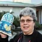 Ann Dennison with her household waste from July  - a little more than her usual monthly rubbish....
