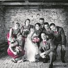 Anna Deans and Colin Lee with their bridal party at their wedding, which took place on Anna's...