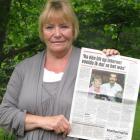 Anna Skeet, of Alexandra, holds a Dutch newspaper containing a photo of her and new-found half...