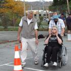 Anne Mills, of Alexandra, pushed by blindfolded Dave Cox, of Dunedin, competes in a wheelchair...
