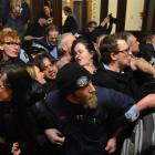 Anti-Trans Pacific Partnership protesters try to disrupt a National Party event in Dunedin last...
