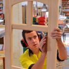Apprentice joiner James Buchanan sands the door that qualified him for the WorldSkills...