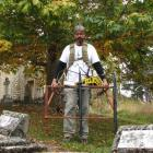 Archaeologist Hans-Dieter Bader uses ground-penetrating radar to find unmarked graves in the St...