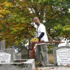 Archaeologist Hans-Dieter Bader uses ground penetrating radar to find unmarked graves in the St...