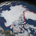 Arctic sea ice hits its annual minimum as seen in this satellite picture. The red line  shows the...