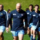 Argentina captain Felipe Contepomi (C) walks with teammates during a training session in...