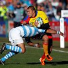 Argentina's Alfredo Lalanne (L) tackles Romania's Ionel Cazan during their Rugby World Cup Pool B...