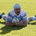 Argentina's Genaro Fessia scores against Romania. REUTERS/Brandon Malone