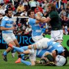Argentina's Gonzalo Camacho (2nd L) fights for the ball with South Africa's Andrei Bekker (R)...