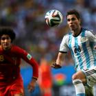 Argentina's Jose Basanta (R) tries to control the ball as Belgium's Marouane Fellaini approaches....