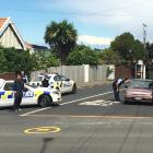 Armed police at the intersection of  Eglinton and Neidpath Roads in Mornington. Photo by Hamish...