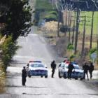 Armed police cordon off Narrowdale Rd, Milburn, while the Armed Offenders Squad detains a man who...