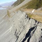 The moraine wall of the receding Tasman Glacier, with the Ball Shelter perched near the moraine...