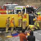 Arrowtown and Frankton volunteer fire brigade members use the jaws of life to extract the male...