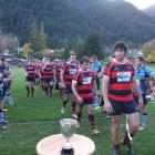 Arrowtown captain Ben Chisholm eyes up part of the silverware his team collected after  its 30-20...
