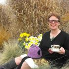 Arrowtown spring flower show committee member Wendy Clarke sits among the daffodils,  ready for...