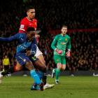 Arsenal's Danny Welbeck shoots to score against Manchester United. Action Images via Reuters /...