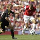 Arsenal's Gael Clichy, right, competes with Liverpool's Dirk Kuyt during their English Premier...