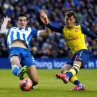 Arsenal's Mesut Ozil (R) shoots to score against Brighton and Hove Albion during their FA Cup...