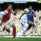 Arsenal's Robin Van Persie sprints after the ball with Chelsea's Ashley Cole in hot pursuit.  ...