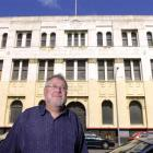 Assoc Prof Alexander Trapeznik outside the old NMA building on the corner of Water St.