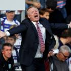 Aston Villa manager Alex McLeish reacts during his team's Premier League match against Queens...