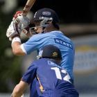 Auckland batsman Anaru Kitchen plays a shot in front of Otago wicketkeeper Derek de Boorder...