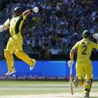 Australia's Aaron Finch (L) celebrates with team mate and captain George Bailey after reaching...