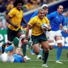 Australia's Digby Ioane heads for the try line against Italy during their Rugby World Cup Pool C...
