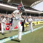Australia's Michael Clarke runs onto the Adelaide cricket ground at the start of day two. REUTERS...