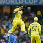 Australia's Mitchell Johnson celebrates after bowling out India's Rohit Sharma. REUTERS/David Gray